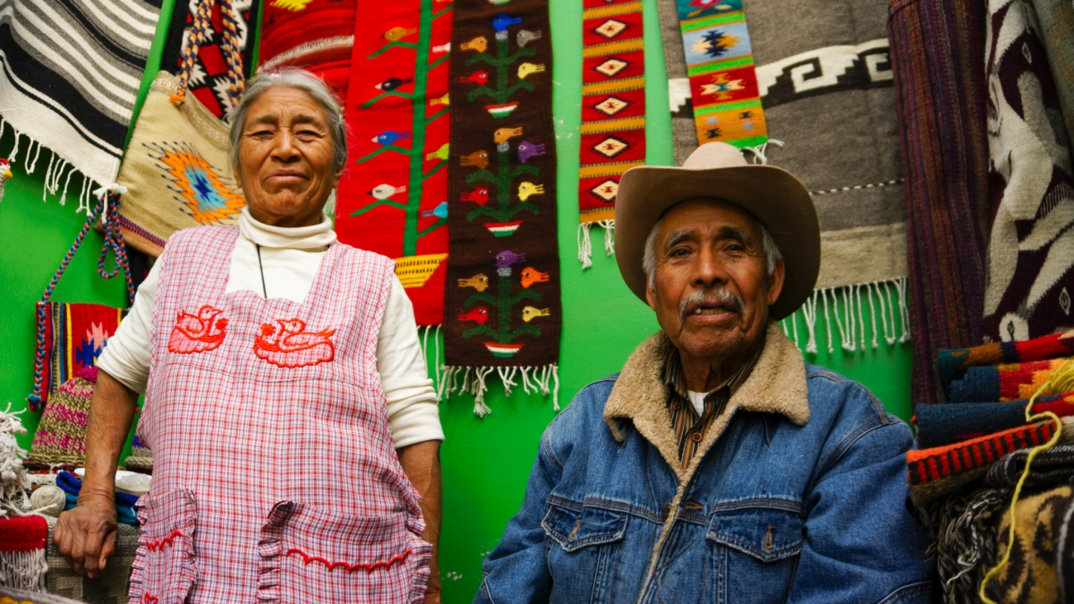 Oaxaca Artisans showing their handwoven crafts